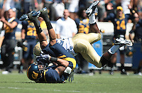 Marvin Jones makes the tough catch. The University of California Berkeley Golden Bears defeated the UC Davis Aggies 52-3 in their home opener at Memorial Stadium in Berkeley, California on September 4th, 2010.