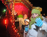 Fish Robinson (from l.), Adam Robinson, and Piper Clark waves from The Regents School float at the Christmas parade in Oxford, Miss. on Monday, December 6, 2010.