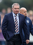 Ally McCoist storms off towards the dressing room in a rage