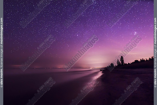 Beautiful starry night sky above the shore of lake Huron, Ontario, Canada