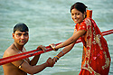 Wife and husband bless their wedding with a brave dip in the cold waters of the Early morning. Upanishads say married people have to take bath twice daily.