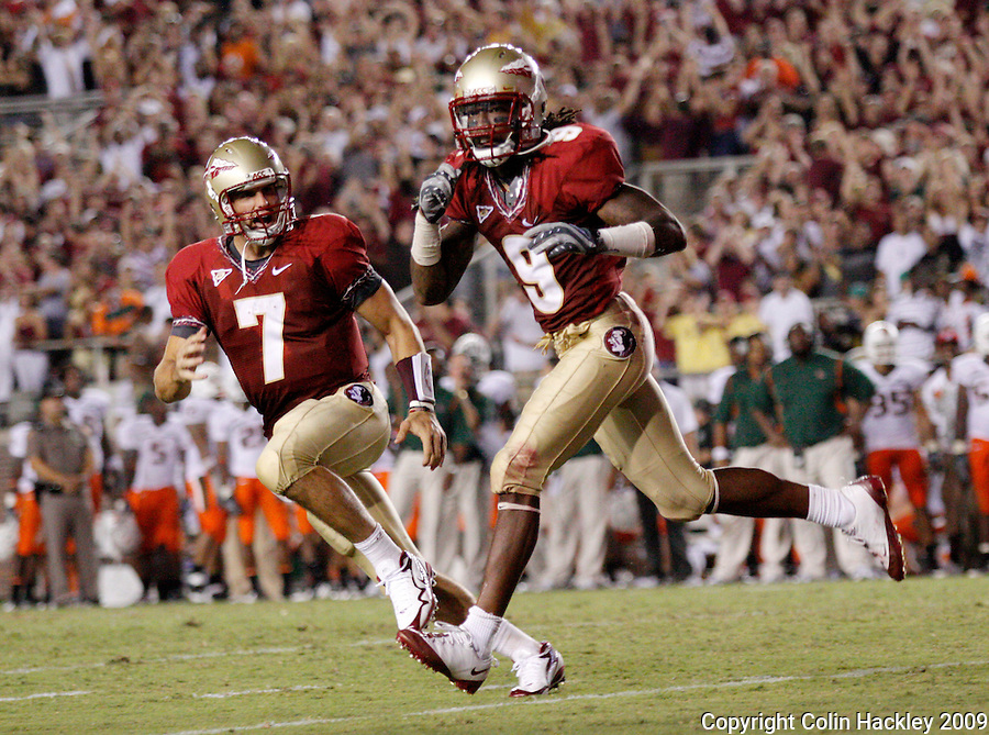 TALLAHASSEE, FL 9/7/09-FSU-MIAMIFB09 CH23-Florida State's Christian Ponder, left, and Richard Goodman celebrate a touchdown against Miami's during second half action Monday at Doak Campbell Stadium in Tallahassee. The Seminoles lost to the Hurricanes 38-34...COLIN HACKLEY PHOTO