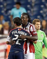 Chivas USA midfielder Shalrie Joseph (18) hugs former teammate New England Revolution substitute midfielder Benny Feilhaber (22). In a Major League Soccer (MLS) match, the New England Revolution tied Chivas USA, 3-3, at Gillette Stadium on August 29, 2012.