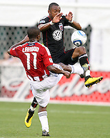 Rodney Wallace #22 of D.C. United crashes past Michael Lahoud #11 of Chivas USA during an MLS match at RFK Stadium, on May 29 2010 in Washington DC. United won 3-2.