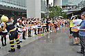 July 31st, 2011- Tokyo, Japan- Maid cosplayers and fans sprinkling water together: This summer, Japan is concerned for saving electricity due to the Fukushima nuclear plant disaster. Maids cos-players are doing water sprinkling to make the temperature cooler in Akihabara, Japan.(Photo by Yumeto Yamazaki/AFLO)