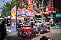 Fried chicken and other foods for sale at a street fair in the Greenwich Village neighborhood of New York on Saturday, June 21, 2014. (© Richard B. Levine)