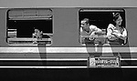 Passengers on a train passing through Hua Hin, Thailand.