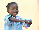 A girl washes laundry in a camp in Port-au-Prince for families left homeless by Haiti's devastating January 12 earthquake.