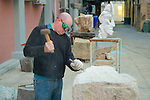 Artist Carving Stone