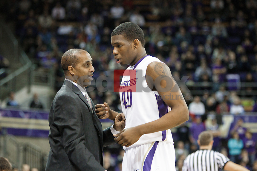Shawn Kemp, Jr., .Lorenzo Romar - Head Coach...---Washington Huskies men's basketball against the California Golden Bears at Alaska Airlines Arena at Hec Edmundson Pavilion in Seattle on Thursday, January 19, 2012. (Photo by Dan DeLong/Red Box Pictures)