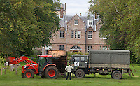 Carnell Estate - Hurlford, Scotland. The estate manager moves a tractor and an old army truck to stop people seeing into the front of the home that Angelina Jolie, and her partner Brad Pitt are renting for two weeks while filming World War Z in Glasgow..Picture: Universal News And Sport (Scotland). 18 August 2011. www.unpixs.com..