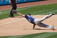 08/28/11 Los Angeles, CA: Colorado Rockies third baseman Kevin Kouzmanoff dives for a line drive during a MLB game played at Dodger Stadium between the Los Angeles Dodgers and the Colorado Rockies.  The Rockies defeated the Dodgers 7-6