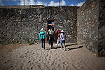 "Tourists walk through ""The French Tiger Cages"" on Con Son Island, part of the Con Dao Islands.The 16 mountainous islands and islets are situated about 143 miles southeast of Ho Chi Minh City in Vietnam, in the South China Sea. The Tiger Cages were built in 1940.  Eleven prisons were built on the island and are now open for tours.  Photo taken Thursday, May 5, 2010...Kevin German / LUCEO For the New York Times"