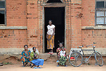 People waiting at the doorway of the United Methodist hospital in the Congolese village of Tunda.
