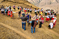 Peruvian peasants dance before the Yawar Fiesta, a ritual fight between the condor and the bull, held in the mountains of Apurímac, Cotabambas, Peru, 28 July 2012. The Yawar Fiesta (Feast of Blood), an indigenous tradition which dates back to the time of the conquest, consists basically of an extraordinary bullfight in which three protagonists take part - a wild condor, a wild bull and brave young men of the neighboring communities. The captured condor, a sacred bird venerated by the Indians, is tied in the back of the bull which is carefully selected for its strength and pugnacity. A condor symbolizes the native inhabitants of the Andes, while a bull symbolically represents the Spanish invaders. Young boys, chasing the fighting animals, wish to show their courage in front of the community. However, the Indians usually do not allow the animals to fight for a long time because death or harm of the condor is interpreted as a sign of misfortune to the community.
