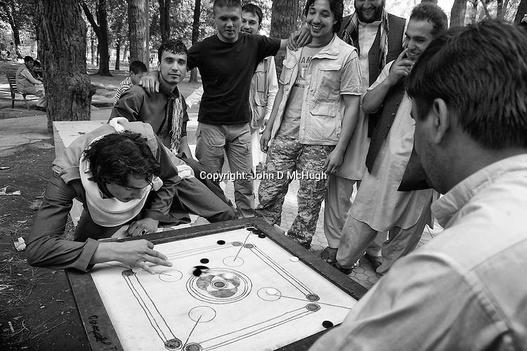 Afghan men play board games in Shar-I Now park, 31 August 2012. (John D McHugh)
