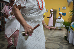 RIO DE JANEIRO, BRAZIL - JANUARY 24: Practitioners perform rituals in a candomble ceremony, in Rio de Janeiro, Brazil, on Saturday, Jan. 23, 2015. Brazil's Afro-Brazilian religions which in recent years have come under increasing threats and prejudice, particularly from the growing number of evangelical churches. Candombl&eacute; originated in Salvador, Bahia at the beginning of the 19th century when enslaved Africans brought their beliefs with them. Umbanda and candombl&eacute; are Afro-Brazilian religions practiced in mostly Brazil. <br /> (Lianne Milton for the Washington Post)