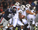 Ole Miss defensive tackle Gilbert Pena (99) vs. Vanderbilt wide receiver Wesley Tate (24) at Vaught-Hemingway Stadium in Oxford, Miss. on Saturday, November 10, 2012.