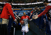Ohio State Buckeyes guard Lenzelle Smith Jr. (32) high fives fans as he heads to the court before the second-round NCAA Tournament game between the Ohio State Buckeyes and the Dayton Flyers at the First Niagara Center, Thursday afternoon, March 20, 2014. The Dayton Flyers defeated the Ohio State Buckeyes 60 - 59. (The Columbus Dispatch / Eamon Queeney)