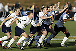 05 December 2004: Notre Dame players rush their goalkeeper after her save won the championship. Notre Dame defeated UCLA 4-3 on penalty kicks after the game ended in a 1-1 overtime tie at SAS Stadium in Cary, NC in the championship match in the 2004 NCAA Division I Women's College Cup...
