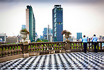 Outside terrace at the Chapultepec Castle overlooks Paseo de la Reforma and its modern buildings.  The castle is located in Chapultepec Park in Mexico City at an elevation of 7,628 feet.