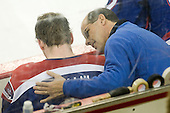 Artie Poitras checks on Terrence Wallin (UML - 9). - The Boston College Eagles defeated the visiting University of Massachusetts Lowell River Hawks 6-3 on Sunday, October 28, 2012, at Kelley Rink in Conte Forum in Chestnut Hill, Massachusetts.
