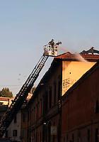 Roma  15 Ottobre 2011.Manifestazione contro la crisi e l'austerità.I manifestanti incendiano un edificio del ministero della Difesa,intervengono i vigili del fuoco .