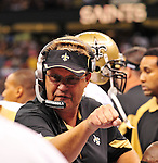 """File-Greg Williams, Defensive Coordiantor for the New Orleans Saintshas been suspended indefiently from the NFL  because of his """"bounty system"""" he had in place while coaching for the Saints during ht e2009,2010 & 2011 NFL seasons. Coach Sean Payton was suspended for one year and General manager Micky Lookis was suspended for 8 games for thier roles in the """"Bounty scandal"""". File Photo of Defensive coach Greg Willams letting his defensive line know what to do during the Saints pre season game against the San Diego Chargers Friday Aug 27,2010. The San Diego charges cut Drew Brees a few years ago, allowing him to be picked uop by the Saints as a free agent. The Saints won 36-21 at half time.Photo© Suzi Altman"""