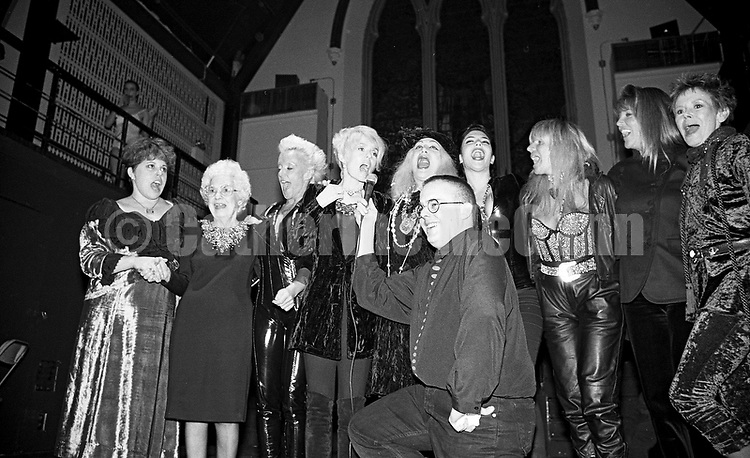 """December 5, 1990:  Michael Musto's birthday party at the Limelight nightclub in New York City.  L-R:  Sukreet Gabel, the star of the Lifetouch commercial (""""I've fallen and I can't get up!""""), High Voltage, Joey Heatherton, Sylvia Miles, Toni Senecal, Robin Byrd, Roxanne Pulitzer and Judy Carne.  Publicist Chip Duckett in front and Michael Alig on balcony in rear."""