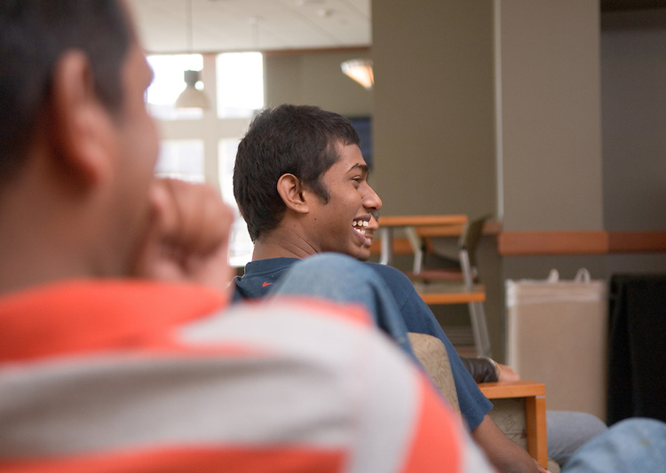 18110Students Venu Kotha(left) and Mathivanan Sivanesan(middle) Watch the ICC Cricket World Cup, India vs. Sri Lanka in Baker Center on Friday, March 23rd