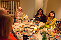 SEATTLE, WA-APRIL 17, 2017: Amanda Saab, center, Anjana Agarwal,  and Charissa Pomrehn (yellow sweater, right) had a lot to laugh about during the dinner party.<br /> <br /> Amanda Saab, along with her husband Hussein Saab, co-hosted a &quot;dinner with your Muslim neighbor&quot; at the home of Stefanie and Nason (cq) Fox in Seattle, WA on a return trip April 17th 2017. The couple now live in Detroit. (Photo by Meryl Schenker/For The Washington Post)