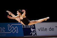 Jennifer Colino of Spain straddle jumps during early training at 2006 Thiais Grand Prix in Paris, France on March 23, 2006.  (Photo by Tom Theobald)
