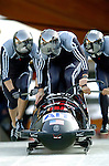 20 November 2005: Todd Hays leads the USA 1 sled pushoff in the first run of the 2005 FIBT AIT World Cup Men's 4-Man Bobsleigh Tour, at the Verizon Sports Complex, in Lake Placid, NY. Mandatory Photo Credit: Ed Wolfstein. The USA 1 team was disqualified after a crash ejected 2 competitors in the second run of the day.