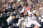 Seattle Seahawks defensive end Raheem Brock (98) and linebacker Dexter Davis (58) pass rushes Minnesota Vikings quarterback Christian Ponder at CenturyLink Field in Seattle, Washington August 20, 2011. The Vikings beat the Seahawks  20-7. ©2011 Jim Bryant Photo. All Rights Reserved.