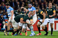 Adriaan Strauss of South Africa is tackled by Ramiro Herrera of Argentina. Rugby World Cup Bronze Final between South Africa and Argentina on October 30, 2015 at The Stadium, Queen Elizabeth Olympic Park in London, England. Photo by: Patrick Khachfe / Onside Images