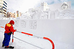 A school child Children makes a sketch of an ice sculpture depicting a scene fro the Chronicles of Narnia during the snow and ice festival in Sapporo City, northern Japan. About 2 million people visit the city to see the hundreds of hand-crafted snow and ice sculptures that have graced the Sapporo Snow Festival since its inception in 1950.