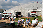Festival goers enjoy the summer sunshine. The Hay Festival, Hay on Wye, Powys, Wales, Great Britain. 2006.