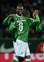 FUSSBALL   1. BUNDESLIGA   SAISON 2013/2014   11. SPIELTAG SV Werder Bremen - Hannover 96                         03.11.2013 Assani Lukimya (li) und Cedrick Makiadi (v.l., beide SV Werder Bremen) jubeln nach dem 2:1