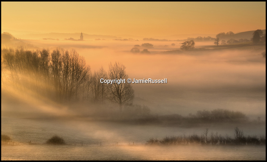BNPS.co.uk (01202 558833)<br /> Pic: JamieRussell/BNPS<br /> <br /> ***Please Use Full Byline***<br /> <br /> The dawn mist just outside of Carisbrooke, Isle of Wight. <br /> <br /> Stunning photographs have revealed a turbulent side to the normally genteel Isle of Wight.<br /> <br /> The seemingly benign south coast holiday destination has been catalogued over a stormy year by local photographer Jamie Russell, and his astonishing pictures reveal the dramatic changes in weather that roll across the UK in just 12 months.<br /> <br /> Lightning storms, ice, floods, gales and blizzards have all been captured by the intrepid photographer who frequently got up in the middle of the night to capture the climatic chaos.<br /> <br /> Looking at these pictures prospective holidaymakers could be forgiven for thinking twice about a gentle staycation on the south coast island.
