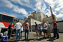8/28/2008--Hanford, WA, USA..Tourists finish a tour the B-Reactor at the Hanford Site, Washington, along the banks of the Columbia River. The reactor was the first large scale plutonium production reactor ever built and started production in December, 1944. The project was commissioned under the Manhattan Project, during World War II, to develop the first nuclear weapons. The B-REactor was shut down in 1968 and on August 25th, 2008, was declared a National Historic Landmark and is now open to tourists...The reactor was graphite moderated and water cooled. It consisted of a 28 by 36-foot, 1,200-ton graphite cylinder lying on its side, penetrated through its entire length horizontally by 2,004 aluminum tubes, the ends which can be seen here. Two hundred tons of uranium slugs the size of rolls of quarters and sealed in aluminum cans went into the tubes...During the Cold War, the Hanford project was expanded to include nine nuclear reactors and five massive plutonium processing complexes, which produced plutonium for most of the 60,000 weapons in the U.S. nuclear arsenal. The weapons production reactors were decommissioned at the end of the Cold War, but the manufacturing process left behind 53 million U.S. gallons of high-level radioactive waste that remains at the site. Hanford is the most contaminated nuclear site in the United States and is the focus of the nation's largest environmental cleanup, providing thousands of jobs to residents in nearby towns such as Richland...©2008 Stuart Isett. All rights reserved.