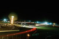 DAYTONA BEACH, FL - FEBRUARY 1: A time-exposure photograph illustrating streaks of taillights and turbocharger flames during the 24 Hours of Daytona IMSA GT race at the Daytona International Speedway in Daytona Beach, Florida, on February 1, 1987.