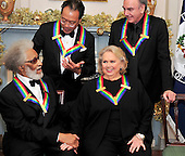 Sonny Rollins, Yo-Yo Ma, Barbara Cook, and Neil Diamond,  recipients of the 2011 Kennedy Center Honors, share some thoughts as they wait to pose for a photo following a dinner hosted by United States Secretary of State Hillary Rodham Clinton at the U.S. Department of State in Washington, D.C. on Saturday, December 3, 2011. The 2011 honorees are actress Meryl Streep, singer Neil Diamond, actress Barbara Cook, musician Yo-Yo Ma, and musician Sonny Rollins..Credit: Ron Sachs / CNP
