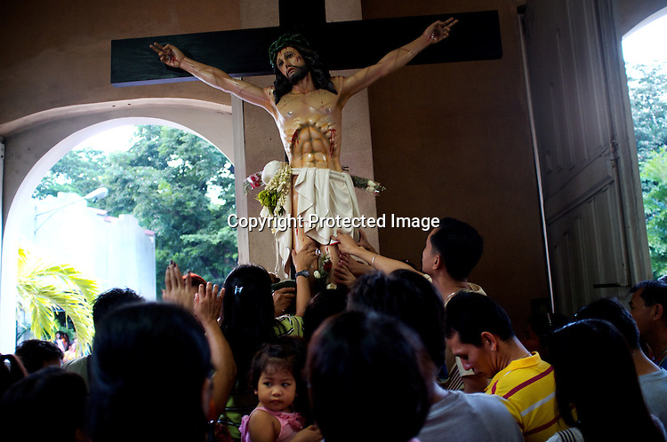 "Worshippers touch the statue of Jesus Christ on wednesday evening at the Redemptorist Church in Baclaran in Manila, Philippines. The Baclaran church is said to be the most attended church in Asia drawing up to 100,000 worshippers "" in Manila, Philippines. Photo: Sanjit Das"