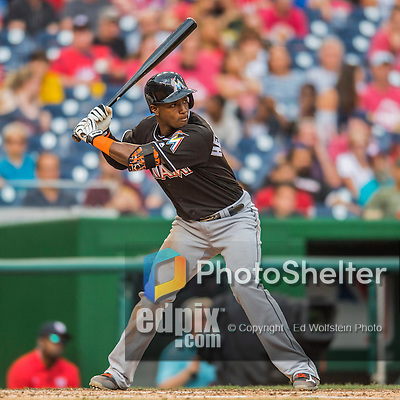 14 May 2016: Miami Marlins infielder Adeiny Hechavarria in action during the first game of a double-header against the Washington Nationals at Nationals Park in Washington, DC. The Nationals defeated the Marlins 6-4 in the afternoon matchup.  Mandatory Credit: Ed Wolfstein Photo *** RAW (NEF) Image File Available ***