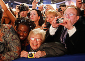 Washington, DC - January 20, 2009 -- Dr. Ruth Westheimer (C) smiles as she watches US President Barack Obama and First Lady Michelle Obama dance on January 20, 2009 in Washington, DC during the Western Inaugural Ball. .Credit: Chip Somodevilla - Pool via CNP