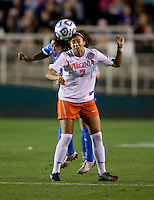 Caprice Dydasco (3) of UCLA goes up for a header with Glorida Douglas (7) of Virginia during the Women's College Cup semifinals at WakeMed Soccer Park in Cary, NC. UCLA advance on penalty kicks after typing Virginia, 1-1 in regulation time.