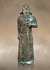 Neo-Assyrian basalt statue of King Shalmaneser III (858-824 B.C) . Inscription reads &quot;Shalmaneser, the great king, the mighty king, king of all four region, the powerful and the mighty rival of the princes of the whole earth the great ones, the kings, son of Assur-Nasirapli, King of the universe, King of Assyria, grandson of ~Tukultiu-Ninurta, King of the Universe, King of Assyria&quot;. The inscription continues with his campaigns &amp;b deeds in Uratu, Syria, Que &amp; Tabal ending &quot; At the time I rebuilt the walls of my city Ashur from their foundations to their summits. I made an image of my royal self and set it up in the metal gate&quot;. From Assur ( Qala't Sharqat) Iraq. Istanbul Archaeological Museum, Inv no. 4650.