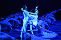 London, UK. 31.05.2016. English National Ballet presents SWAN LAKE in the round at the Royal Albert Hall. Picture shows: Osiel Gouneo (Prince Siegfried), Alina Cojocaru (Odette). Photograph © Jane Hobson.