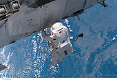 "In Earth Orbit - September 12, 2006 -- It was ""installation day"" on the International Space Station on September 12, 2006. The Space Shuttle Atlantis and International Space Station (ISS)Expedition 13 crews worked on attaching the P3/P4 truss during the first of three scheduled spacewalks by STS-115 shuttle crew members. Astronaut Joseph R. Tanner, mission specialist, pictured as he translated along the station hardware, was joined by astronaut Heidemarie M. Stefanyshyn-Piper, mission specialist..Credit: NASA via CNP"