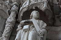 Statue under a canopy, possibly St Thomas with his set square, on the South Portal, 1516-18, by Joao de Castilho, 1470ñ1552, after a design by Diogo de Boitaca, Church of Santa Maria, at the Jeronimos Monastery or Hieronymites Monastery, a monastery of the Order of St Jerome, built in the 16th century in Late Gothic Manueline style, Belem, Lisbon, Portugal. The portal consists of double doors with a tympanum carved with scenes from the life of St Jerome, a statue of Henry the Navigator, many carved statues in niches, a statue of the Madonna and many flamboyant pinnacles and gables in Manueline style. The monastery is listed as a UNESCO World Heritage Site. Picture by Manuel Cohen
